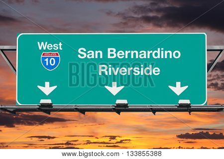 San Bernardino Riverside Interstate 10 west highway sign with sunrise sky.