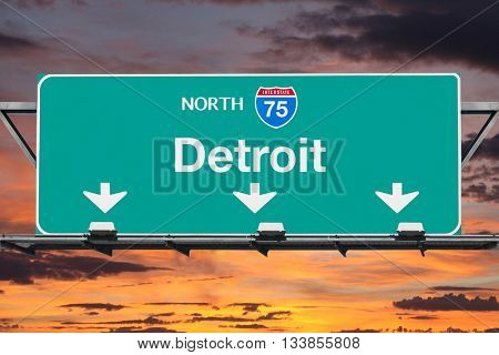 Detroit Michigan Interstate 75 north highway sign with sunrise sky.