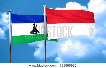 Lesotho flag with Indonesia flag, 3D rendering