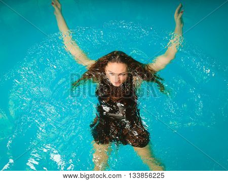Woman Floating Relaxing In Swimming Pool Water.