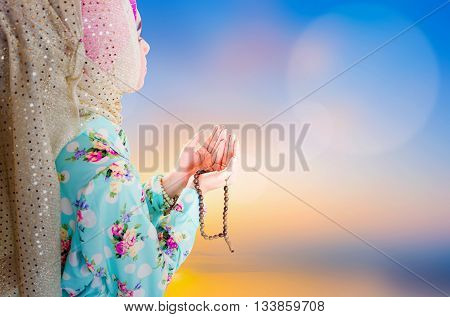 young muslim woman praying for Allah muslim God