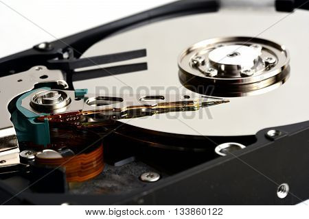 Disassembled computer hard disk drive internals with exposed heads close up