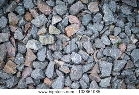 The carpet of crushed granite as background or texture.