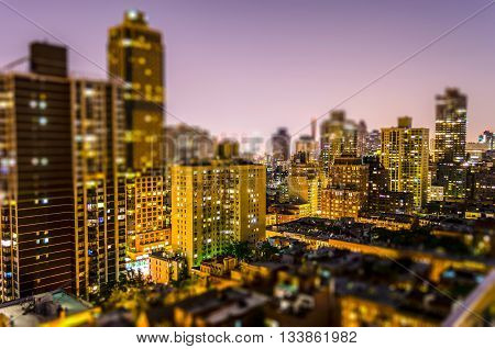 Aerial View Of Manhattan At Night. Tilt-shift Effect Applied