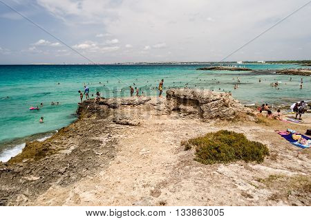 GALLIPOLI ITALY - AUGUST 4: People enjoying a beautiful day at the beach in Punta della Suina near Gallipoli Apulia Italy August 4 2015.