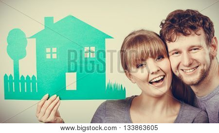 Love relationship ownership property concept. Youthful pair showing model. Adult married man woman presenting home cutout planning future.
