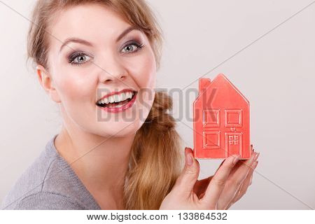Smiling Girl With Home Symbol.