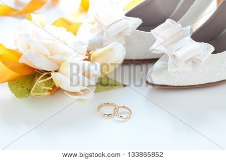 Gold wedding rings for wedding on white backgroundlove
