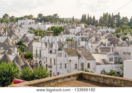 Scenic Panoramic View Of Alberobello And Trulli Buildings, Apulia, Italy
