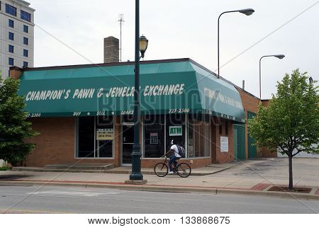 JOLIET, ILLINOIS / UNITED STATES - MAY 24, 2015: One may pawn one's belongings at Champion's Pawn and Jewelry Exchange in downtown Joliet.