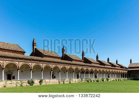 Grand Cloister of the Certosa di Pavia monastery built in 1396-1495 features columns with precious decorations in terracotta portraying saints prophets and angels in white and pink Verona marble.