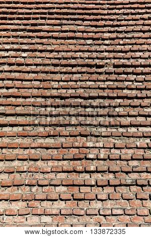 Texture of the medieval brick wall of the Pavia's Cathedral