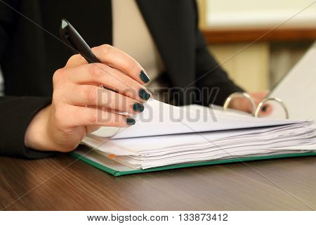 hand of business woman with document viewer