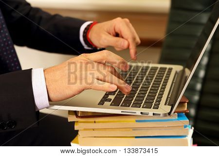 hands of business people working on laptop