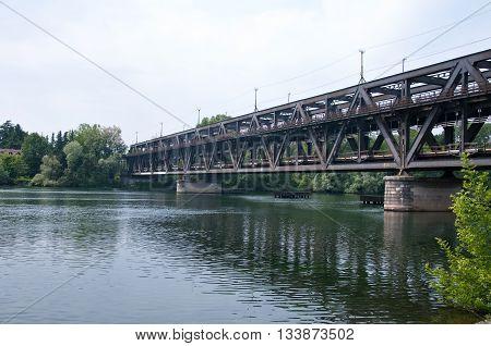 beautiful old wrought iron bridge on Ticino river