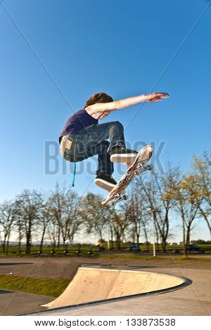 Boy Going Airborne With The Skate Board