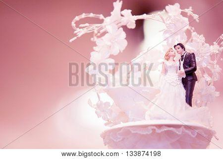 miniature wedding couple dolls on top cake