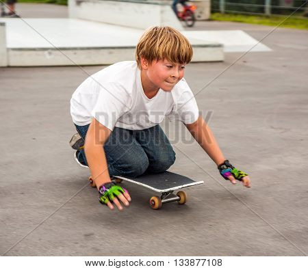 Boy Is Sitting At A Box In The Skate Park