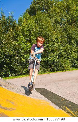 Boy Has Fun Riding His Scooter