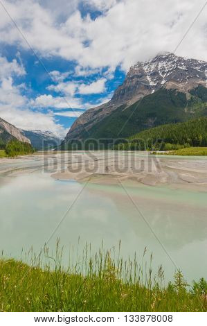 Landscape of Mount Stephen with the Kicking Horse river in the foreground.