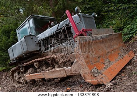 Dirty tractor in the ground