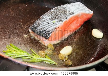 Fillet of Norwegian salmon with garlic, confit tomatoes and pesto