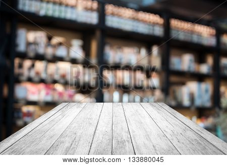 Black and white wooden with coffee shop blurred background with bokeh, stock photo