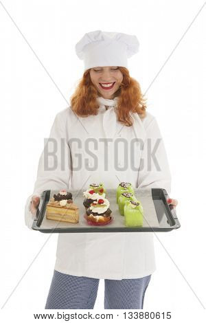 Female baker chef with red hair baked Christmas pastries isolated over white background