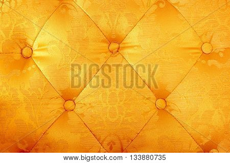Gold silk background fabric sofa for background.