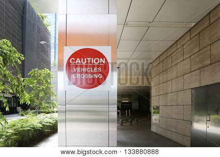 Caution - vehicles crossing sign in the modern building