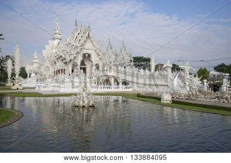 CHIANG RAI, THAILAND - JANUARY 14, 2014: The Wat Rong Khun (White temple) on the outskirts of Chiang Rai. Religious landmark of the city Chiang Rai, Northern Thailand