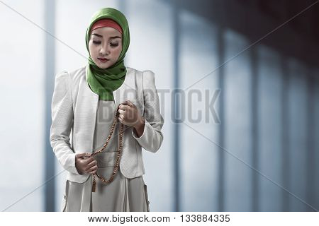 Muslim Woman Holding Prayer Beads