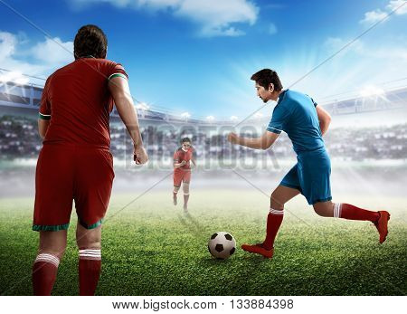 Image of football player dribbling ball intercepted by other