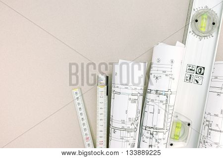 Rolls Of Blueprints And Folding Rule With Spirit Level