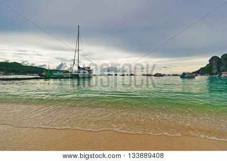 Yachts and different boats in the bay in bad weather. Phi Phi. Thailand