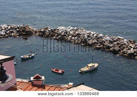 Small boats docked in small Italian port in Cinque Terre