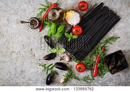 Ingredients For Black Linguine Pasta - Tomato, Basil, Chili Peppers And Mussels. Top View