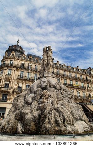 MONTPELLIER, FRANCE - JULY 13, 2015: The three graces fountain at Place de la Comedie. Fountain Three Graces built by sculptor Etienne d'Antoine in 1790.