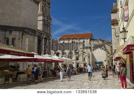 SPLIT, CROATIA - AUGUST 31, 2014: Tourists walking in the Old Town on a summer day. Split is popular touristic coastal destination in Croatia.