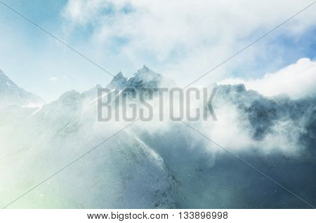 Mountain Peaks And Clouds At Sunset.