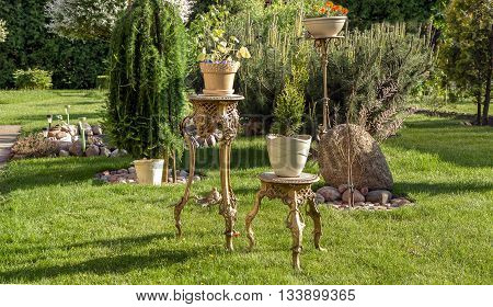 Table With Flowers In The Garden