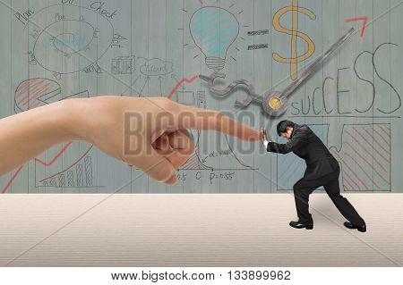 Small man pushing against big woman hand forefinger on table with business concept doodles wooden wall background 3D illustration