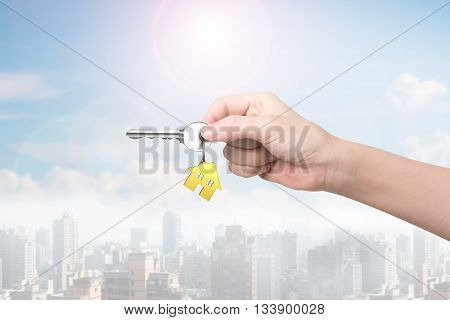 Hand Holding Key With House Shape Key-ring,3D Rendering