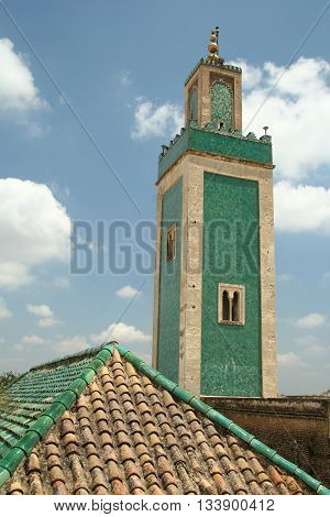 Green minaret and roof, moroccan architecture, Meknes