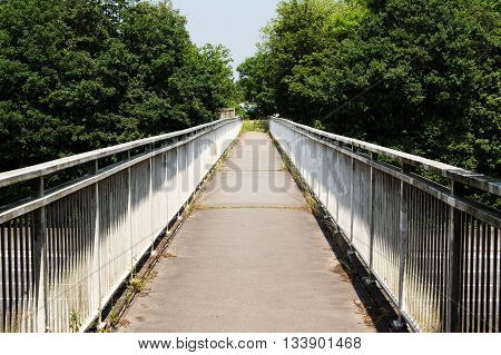 View along a long footbridge with railings on either side