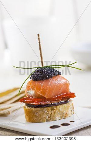 Spanish montadito tapa with salmon and caviar