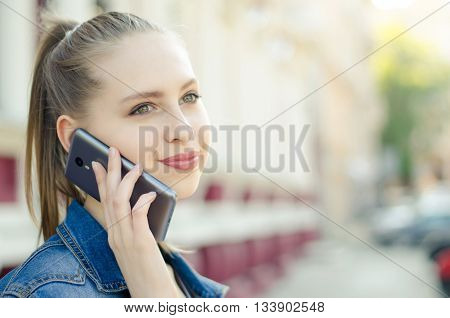 Woman Talking On Mobile Phone In The Street
