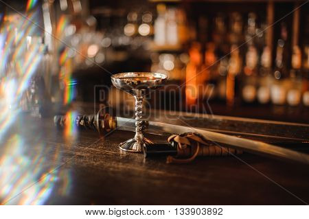 cocktail in a metal glass on bar