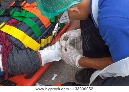 physician doing bandage Injury upper limb of patient. assist patient in emergency rescue situations.(select focus hand physician)