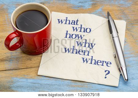 who, what, when, where, why, how brainstorming or decision making questions - handwriting on a napkin with a cup of coffee